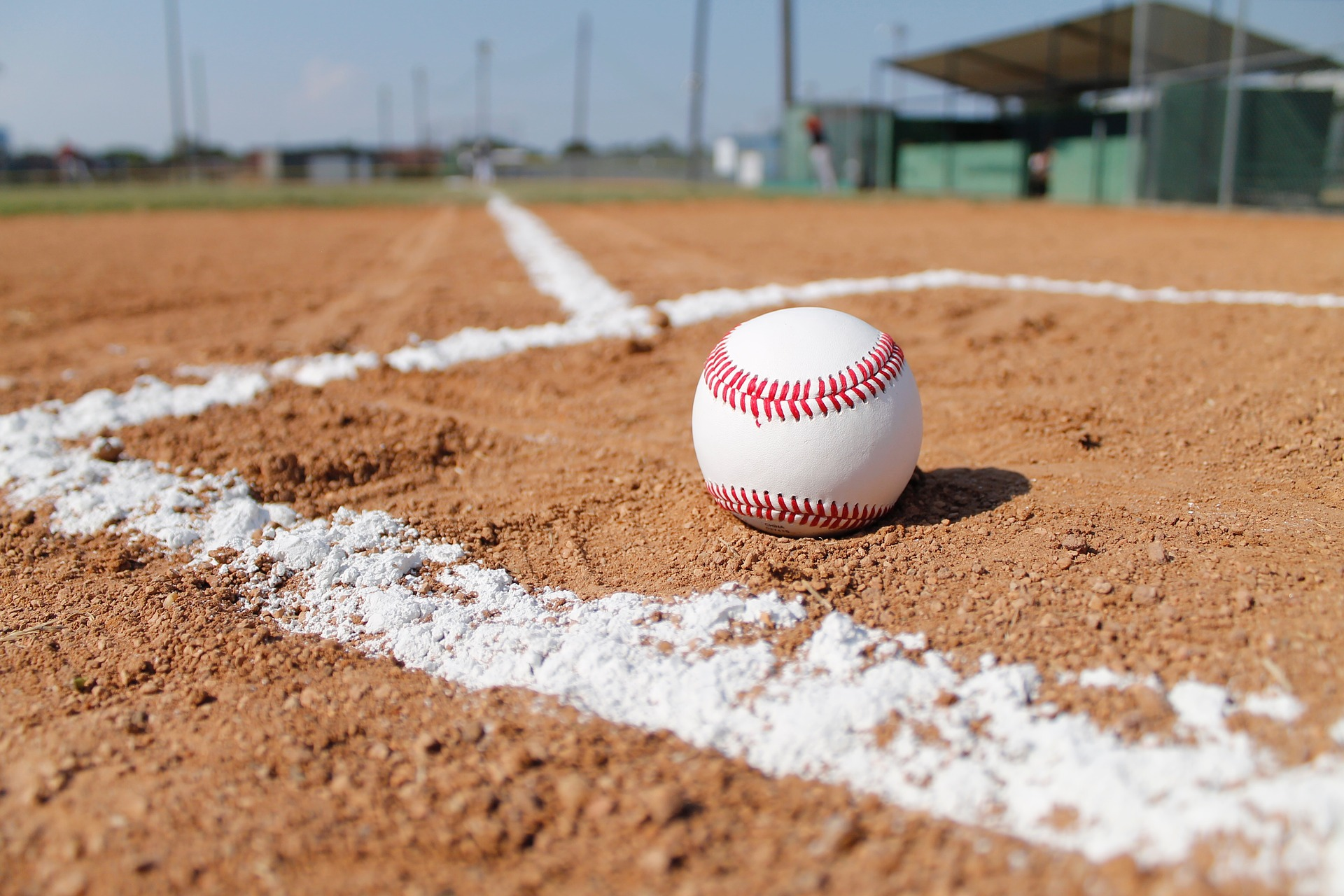 Baseball ball on a baseball field. The ball is placed in a boxed area used white pitch lines: Baseball vs Softball [MindfuseBaseball.com]