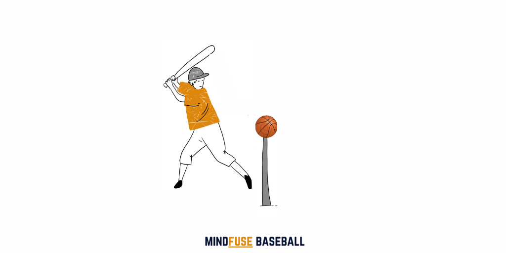 Baseball players hitting a larger ball of the tee called the 'power ball' this is to help batters increase their batting power when swinging at the ball: Baseball Batting Drills